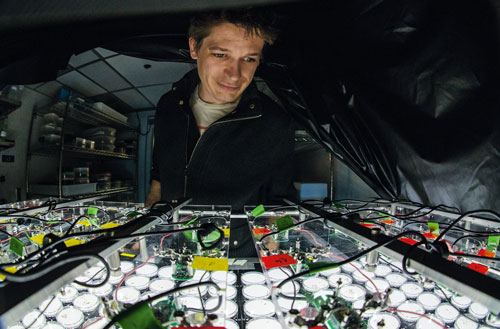 Kronauer during an experiment in which cameras track ant movements.